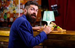 Restaurant client. Hipster formal suit sit at bar counter. Man received meal with fried potato fish sticks meat. Delicious meal. Cheat meal concept. Hipster royalty free stock photos
