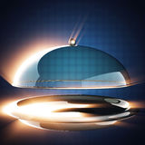 Restaurant cloche on blue background Royalty Free Stock Photo