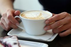Restaurant. Coffee cup on the table Royalty Free Stock Photography