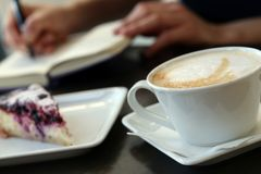 Restaurant. Coffee cup on the table Stock Photos