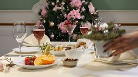 Restaurant concept. New Year and Merry Christmas feast table. Celebration table decoration.. Sliced fruit dish, cheese. Plate and champagne in glasses are stock video footage