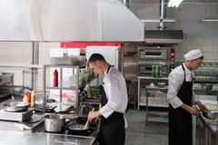 Restaurant chef lifestyle work kitchen cook. Restaurant cook lifestyle. Daily routine of chef working in a kitchen Stock Image