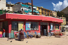 Restaurant in Copacabana, Bolivia. COPACABANA, BOLIVIA - OCTOBER 19, 2014: Unidentified people standing in front of the resto bar Flor de Mi Tierra on the corner Royalty Free Stock Photography