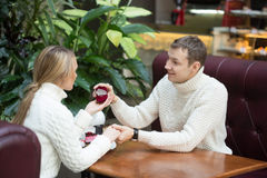 Restaurant, couple and holiday concept - excited young woman looking at boyfriend with engagement ring Stock Photos