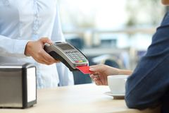 Restaurant customer hand paying with credit card Stock Image