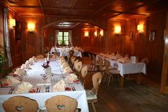 Restaurant decorated for wedding party. Formal wedding lunch is held in the nicely decorated restaurant Stock Photography