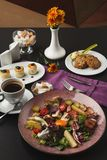 Restaurant breakfast with warm potato salad. Restaurant delicious breakfast with warm potato salad, cheese pancakes, oatmeal cookies and freshly brewed coffee stock photo
