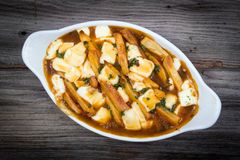 Restaurant delicious poutine meal on table Royalty Free Stock Images