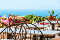 Restaurant desks and chairs near the sea Royalty Free Stock Photo