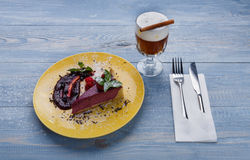 Restaurant dessert. Berry cheesecake with cream soda on blue wood Stock Images