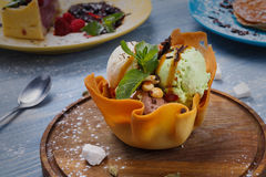 Restaurant dessert. Ice cream scoopes in waffle bowl Royalty Free Stock Photo
