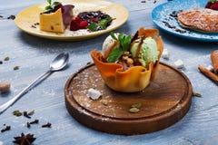 Restaurant dessert. Ice cream scoopes in waffle bowl Stock Image