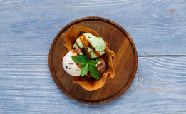 Restaurant dessert. Ice cream scoopes in waffle bowl top view Royalty Free Stock Image