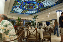 Restaurant dining. Hotel restaurant dining room with stained glass ceiling, at a holiday vacation resort stock image