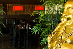 Restaurant dining room with a golden buddha Royalty Free Stock Images