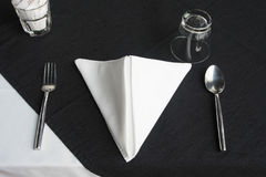 Restaurant dining set on black and white table. Silver spoon on black cloth looks so luxury royalty free stock photography