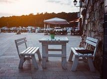 Restaurant dining table outdoors. Stari Grad, Croatia, Dalmatia stock photo
