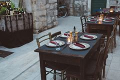 Restaurant dining table outdoors. Stari Grad, Croatia, Dalmatia stock image
