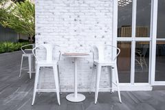 Restaurant dining table on terrace outdoor at evening time. For any use Stock Photography
