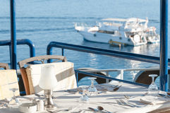 Restaurant Dining Table with a View of Yachts in the Bay Stock Image