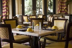 Restaurant Dining Tables Setting. Classy and pleasant restaurant dining tables arrangement Royalty Free Stock Photography