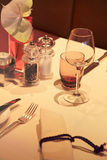 Restaurant dinner table with napkin and wineglass Royalty Free Stock Photos