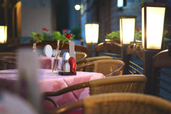 Restaurant dinner table waiting for romantic date. Ambiance lighting in empty outdoor terrace Royalty Free Stock Photo