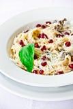 Restaurant dish,pasta with pomegranate seeds Stock Photo