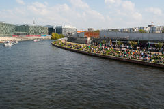 Restaurant on the embankment Spree and pleasure boat. Stock Photography