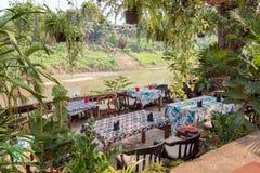 Restaurant en Nam Khan River in Luang Prabang royalty-vrije stock foto's
