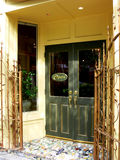 Restaurant entrance. The entrance of a nice restaurant with an extra fancy brass gate in Stock Photo