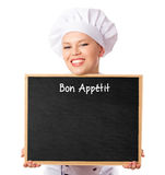 Restaurant female chef holding a blank menu blackboard for notes Royalty Free Stock Photo
