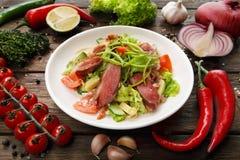 Restaurant food closeup - salad with prosciutto Stock Photo