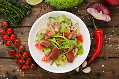 Restaurant Food Closeup - Salad With Prosciutto Royalty Free Stock Image