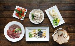 Restaurant food. Dishes served at wooden table Stock Photography