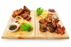 Restaurant food  - grilled meat assortment served on woo Royalty Free Stock Photo