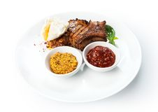 Restaurant food  - grilled pork chop with pashot egg Stock Photography
