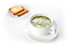 Restaurant food isolated - chicken noodle soup with toast Royalty Free Stock Image