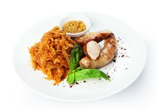 Restaurant food isolated - german sausages with sauerkraut Royalty Free Stock Image