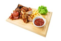 Restaurant food isolated - grilled meat assortment Stock Photos