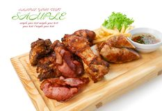 Restaurant food isolated - grilled meat assortment served on woo Royalty Free Stock Images