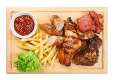 Restaurant food isolated - grilled meat assortment served on woo Royalty Free Stock Photography