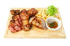 Restaurant food isolated - grilled meat assortment served on woo Stock Images