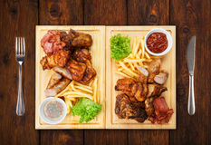 Restaurant food isolated - grilled meat assortment served on woo Royalty Free Stock Photo
