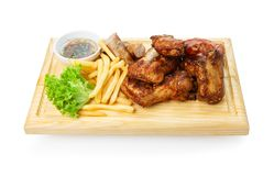 Restaurant food isolated - grilled meat assortment served on wooden board Royalty Free Stock Photography