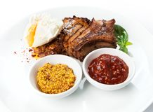 Restaurant food isolated - grilled pork chop with pashot egg Royalty Free Stock Image