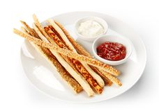 Restaurant food isolated - grissini bread sticks with red and wh Royalty Free Stock Images