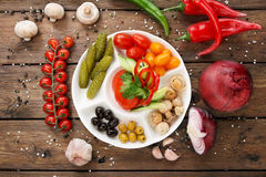 Restaurant food - pickled tomato and cucumber. Stock Photography