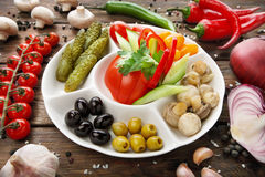 Restaurant food - pickled tomato and cucumber. Royalty Free Stock Image