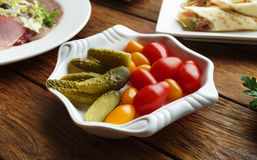 Restaurant food - pickled tomato and cucumber. Royalty Free Stock Images